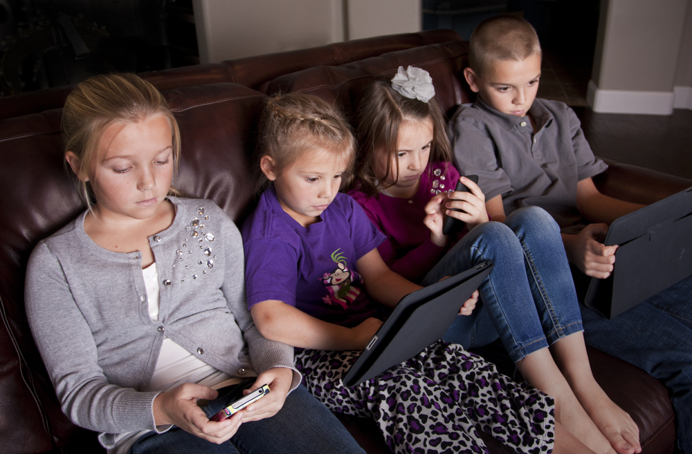 family playing games on mobile devices