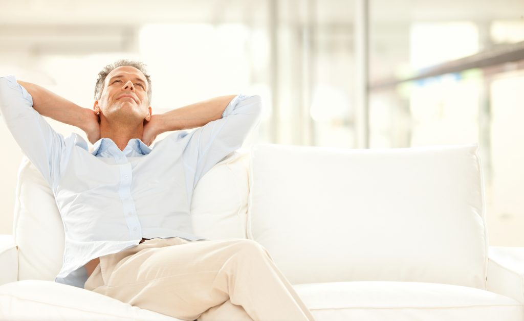 man relaxing on his couch after therapy session