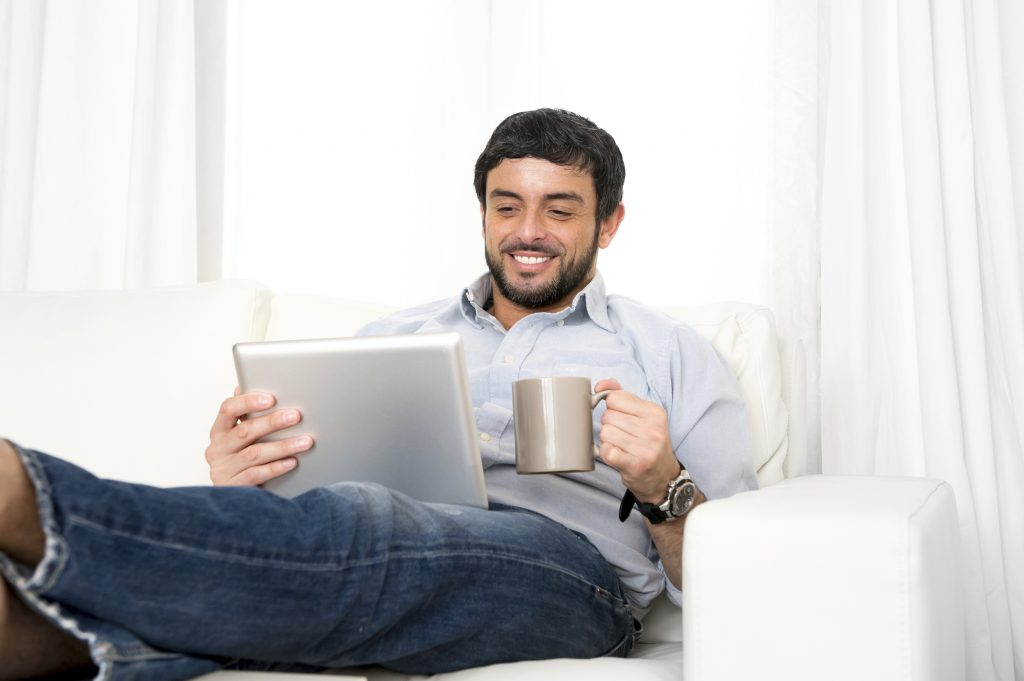 man participating in online psychiatry sesson from home