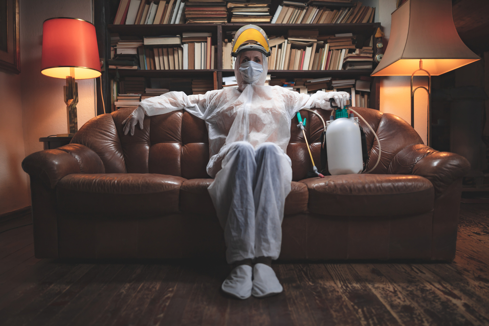 Person with protective antiviral mask, chemical decontamination