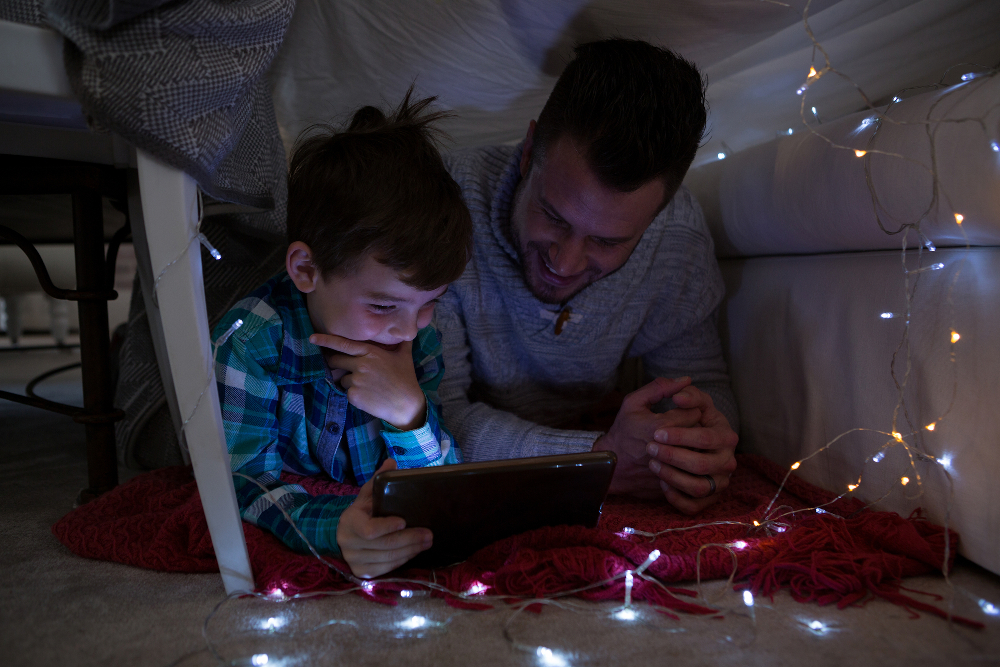 dad and son enjoying some online social time with friends